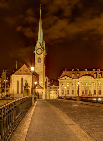 Clock tower of the Fraumunster Cathedral in the city of Zurich, Switzerland at night. A HDR image with tone mapping applied. Stock Photo
