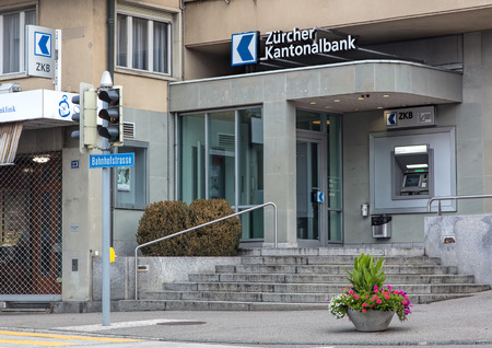 bankomat: Wallisellen, Switzerland - 9 October, 2016: entrance to the Zurich Cantonal Bank office on Bahnhofstrasse street. Cantonal banks are commercial banks, which are provided with a guarantee for the assets held there by the canton in which they are based. Editorial