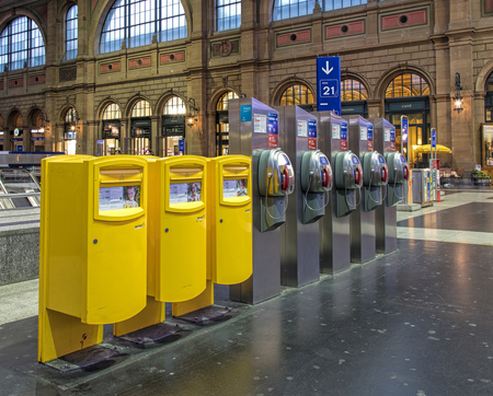 payphone: Zurich, Switzerland - 9 October, 2016: postboxes and payphones in the hall of the Zurich main railway station. Zurich main railway station (German: Zurich Hauptbahnhof or Zurich HB) is the largest railway station in Switzerland and one of the busiest rail Editorial