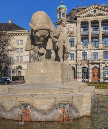 Zurich, Switzerland - 12 February, 2011: Geiserbrunnen fountain on Burkliplatz square. The fountain bears the name of the former city architect, Arnold Geiser, whose legacy financed its creation. The fountain was unveiled in 1911.