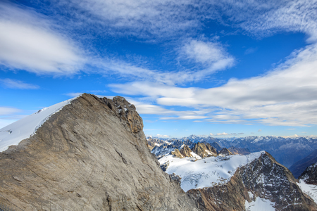 Alps, view from Mt. Titlis - a mountain located on the border between the Swiss cantons of Obwalden and Bern.