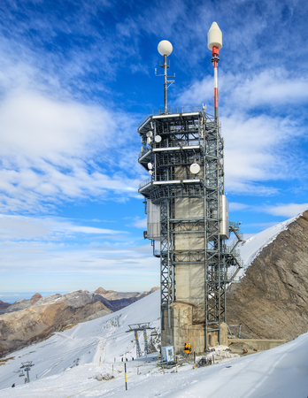 Mt. Titlis, Switzerland - 12 October, 2015: telecommunication tower on the top of the mountain. Mount Titlis is a mountain of the Uri Alps, located on the border between the Swiss cantons of Obwalden and Bern.