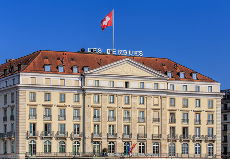 Geneva, Switzerland - 24 September, 2016: facade of the Four Seasons Hotel des Bergues building. The luxurious Hotel des Bergues has been a landmark on Lake Geneva since 1834.