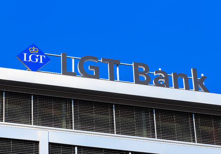 princely: Geneva, Switzerland - 24 September, 2016: LGT Bank sign on the top of an office building. Originally known as Liechtenstein Global Trust, the LGT Group is the private banking and asset management group of the princely House of Liechtenstein. Editorial