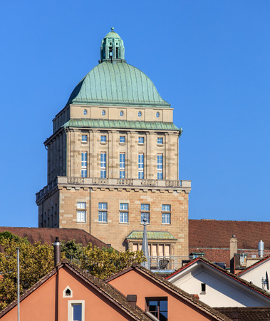 zurich: Zurich, Switzerland - 25 September, 2016: tower of the main building of the University of Zurich. The University of Zurich (German: Universitat Zurich or UZH), located in the city of Zurich, is the largest university in Switzerland, founded in 1833. Editorial