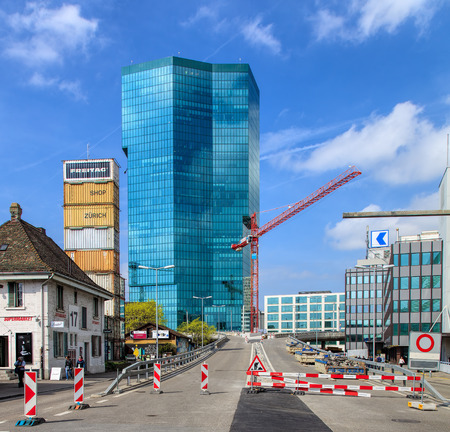 freitag: Zurich, Switzerland - 4 April, 2016: road works on Geroldstrasse street, Prime Tower building in the background. Zurich is the largest city in Switzerland and the capital of the Swiss canton of Zurich. Editorial