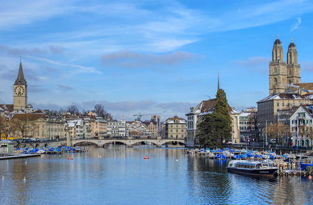 Zurich, Switzerland - 18 January, 2016: view along the Limmat river. Zurich is the largest city in Switzerland and the capital of the Swiss Canton of Zurich.