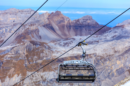 chair on the lift: A seat of a chair lift in the Swiss Alps, shallow depth of field.