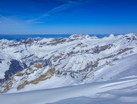 View from Mt. Titlis in Switzerland in winter. Titlis is a mountain, located on the border between the Swiss Cantons of Obwalden and Bern. Stock Photo