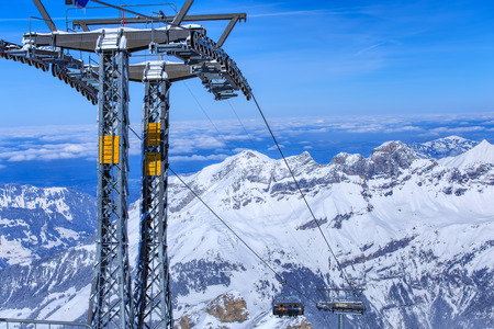 accessed: Mt. Titlis, Switzerland - 9 March, 2016: the Ice Flyer chair lift. Mount Titlis is a mountain of the Uri Alps, located on the border between the Swiss Cantons of Obwalden and Bern, mainly accessed from the town of Engelberg on the north side. Editorial