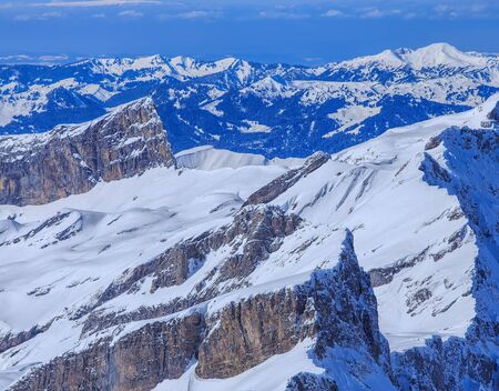 Alps, view from Mt. Titlis in winter. Mount Titlis is a mountain, located on the border between Swiss Cantons of Obwalden and Bern.