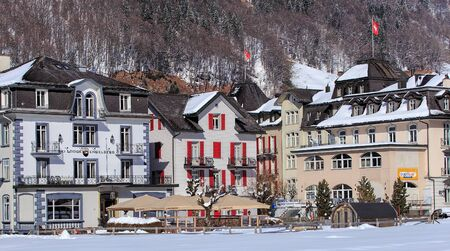 ski lodge: Engelberg, Switzerland - 9 March 2016: buildings along Engelbergerstrasse street. Engelberg is a resort town and municipality in the Swiss canton of Obwalden. Editorial