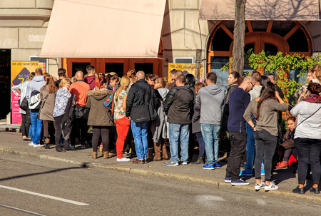 crowds of people: Zurich, Switzerland - 6 November, 2015: people waiting in a queue for a sale to begin. Zurich is the largest city in Switzerland and the capital of the Swiss Canton of Zurich. Editorial