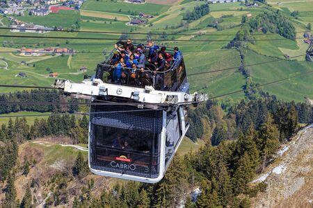 top 7: Mt. Stanserhorn, Switzerland - 7 May, 2016: people in a gondola of the Stanserhorn Cabrio cable car approaching the station on the top of the mountain. Stanserhorn Cabrio is the the worlds first double deck open top cable car, it carries 60 passengers pe
