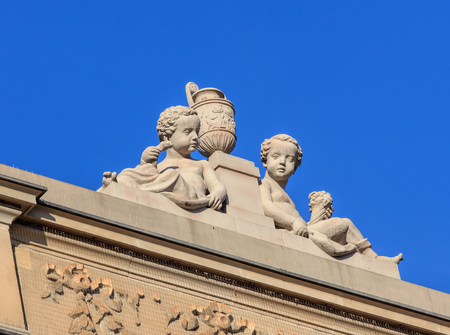 Zurich, Switzerland - 27 December, 2016: sculpture on the top of the Credit Suisse headquarter building on Paradeplatz square. The building was built in 1872-1877, designed by architect Jakob Friedrich Wanner.