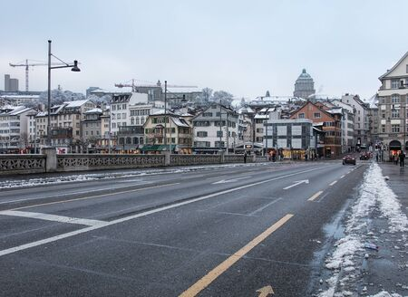 guilds: Zurich, Switzerland - 3 January, 2017: view along the Rudolf Brun bridge on an overcast day in winter. Rudolf Brun bridge is a bridge over the Limmat river, named after Rudolf Brun (1290s-1360), who was the leader of the Zurich guilds revolution of 1336,