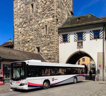 Aarau, Switzerland - 7 July, 2016: a Hess bus  at a bus stop in the old town. Hess is a brand of Carrosserie Hess AG - a bus, trolleybus and commercial vehicle manufacturer, based in the town of Bellach, Switzerland. Aarau is a town and municipality in Sw