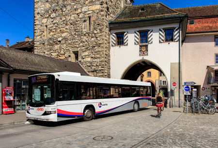 ag: Aarau, Switzerland - 7 July, 2016: a Hess bus at a bus stop in the old town. Hess is a brand of Carrosserie Hess AG - a bus, trolleybus and commercial vehicle manufacturer, based in the town of Bellach, Switzerland. Aarau is a town and municipality in Swi