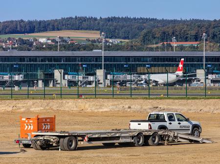tree works: Kloten, Switzerland - 29 September, 2016: construction works in the Zurich Airport. The Zurich Airport, also known as the Kloten Airport, is the largest airport of Switzerland and the principal hub of Swiss International Air Lines.