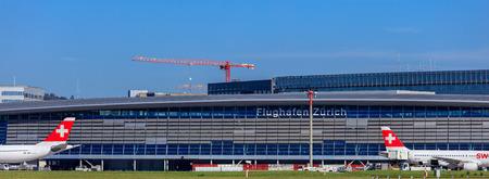 Kloten, Switzerland - 29 September, 2016: the main building of the Zurich Airport, Swiss International Air Lines jets standing at it. The Zurich Airport, also known as the Kloten Airport, is the largest airport in Switzerland and the principal hub of Swis Editorial