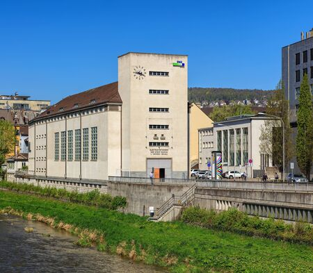 Zurich, Switzerland - 20 April, 2016: the Sihl river and buildings along it. The Sihl is a river that rises near the Druesberg mountain in the Swiss Canton of Schwyz and eventually flows into the Limmat river in the center of the city of Zurich. Editorial
