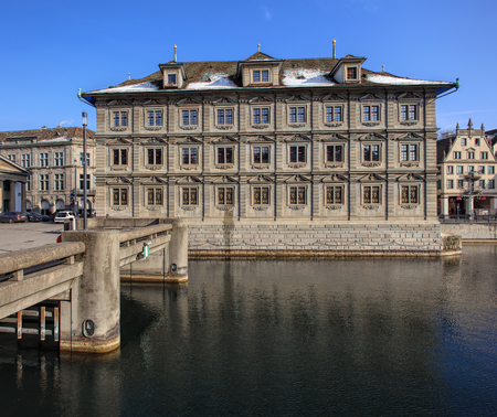 Zurich, Switzerland - 27 January, 2017: the building of the Zurich Town Hall (German: Rathaus) and Rathausbrucke bridge over the Limmat river. The Town Hall building was built during 1694-1698, it houses the Zurich Cantonal Parliament (German: Kantonsrat)