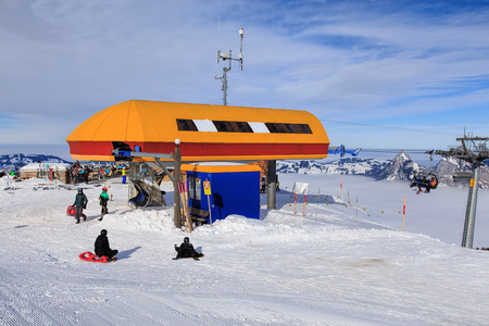 Mt. Fronalpstock, Switzerland - 24 January, 2017: people at the cable car stationon the top of the mountain on a cloudy day in winter. The Fronalpstock is a mountain in the Swiss canton of Schwyz, it has an elevation of 1,921 meters above sea level. The s
