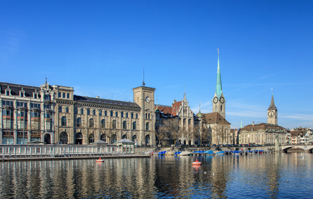 Zurich, Switzerland - 29 January, 2017: well-known buildings of the city of Zurich: the City Hall, the Fraumunster Cathedral, clock tower of the St. Peter Church. Zurich is the largest city in Switzerland and the capital of the Swiss canton of Zurich.