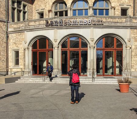 stoop: Zurich, Switzerland - 29 January, 2017: people at the entrance to the Swiss National Museum. The Swiss National Museum (German: Landesmuseum) is one of the most important art museums of cultural history in Europe.