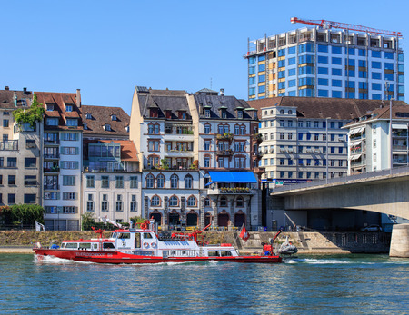 Basel, Switzerland - 27 August, 2016: Christophorus fire departments boat passing along the Rhine river. Basel is a city on the Rhine river in northwestern Switzerland, situated where the Swiss, German and French borders meet. Editorial