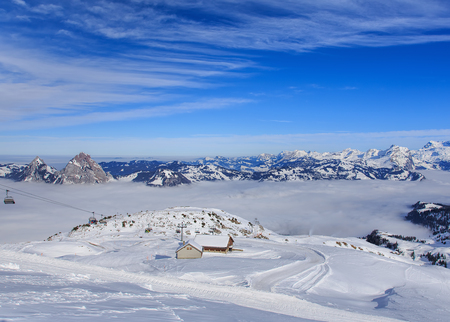 january 1: Mt. Fronalpstock, Switzerland - 24 January, 2017: wintertime view from the summit of the Fronalpstock. The Fronalpstock is a mountain in the Swiss canton of Schwyz, it has an elevation of 1,921 meters above sea level. The summit of the mountain is accessi Editorial