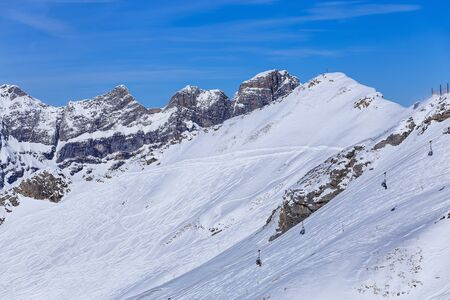 Wintertime view from Mt. Titlis in Switzerland. The Titlis is a mountain, located on the border between the Swiss cantons of Obwalden and Bern. Stock Photo