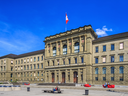 Zurich, Switzerland - 12 April, 2015: facade of the Swiss Federal Institute of Technology building, people on the square in front of it. Swiss Federal Institute of Technology in Zurich (German: Eidgenossische Technische Hochschule Zurich or ETH Zurich) is Editorial
