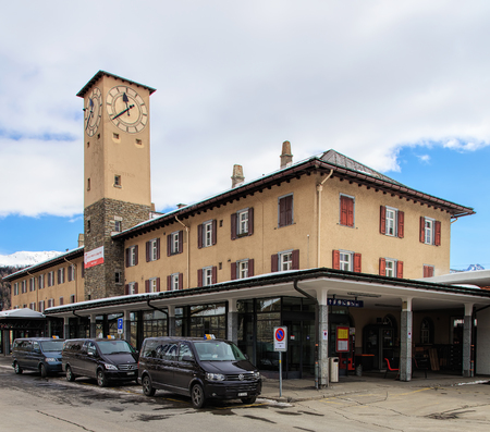 St. Moritz, Switzerland - 3 March, 2017: the buiding of the St. Moritz railway station. St. Moritz is an Alpine resort and a munitipality in the Engadin region of the Swiss canton of Graubunden.