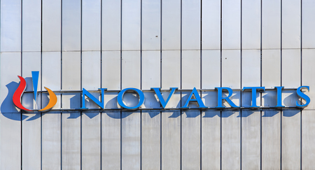 Basel, Switzerland - 27 August, 2016: sign on the wall of a Novartis building. Novartis International AG is a Swiss pharmaceutical company based in Basel, Switzerland, ranking number one in sales in the pharmaceutical industry worldwide. Editorial