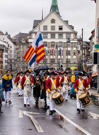 Zurich, Switzerland - 18 April, 2016: participants of the Sechselauten parade passing along Uraniastrasse street. Sechselauten is a traditional spring holiday in the city of Zurich.