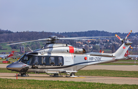 Kloten, Switzerland - 29 March, 2017: an AgustaWestland AW 139 helicopter in the Zurich Airport. The AgustaWestland AW139 is a 15-seat medium-sized twin-engine helicopter developed and produced by AgustaWestland. AgustaWestland S.p.A was a helicopter desi Editorial