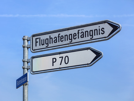 remand: Kloten, Switzerland - 29 March, 2017: sign showing the direction to the Zurich Airport prison (German: Flughafengefangnis). The Zurich Airport Prison is an extradition and remand prison, located in the territory of the Zurich Airport.
