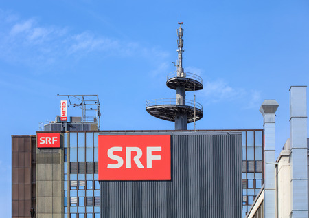 Zurich, Switzerland - 29 March, 2017: upper part of the building of the Swiss Radio and Television company. Swiss Radio and Television (German: Schweizer Radio und Fernsehen or SRF) is a Swiss broadcasting company, established on 1 January 2011. Redakční