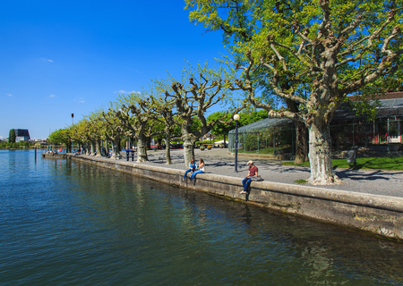 Zug, Switzerland - 6 May, 2016: embankment of Lake Zug in the city of Zug. Lake Zug is a lake in central Switzerland, situated between Lake Lucerne and Lake Zurich, the city of Zug is the capital of the Swiss canton of Zug.