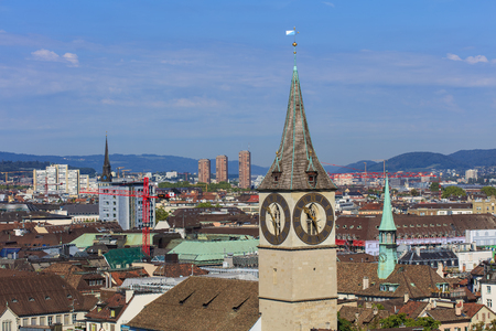 Zurich, Switzerland - 31 August, 2015: view of the city from the tower of the Grossmunster cathedral, clock tower of the St. Peter Church in the foreground. Zurich is the largest city in Switzerland and the capital of the Swiss canton of Zurich. Editorial