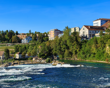Neuhausen am Rheinfall, Switzerland - 26 August, 2015: the Rhine river just above the Rhine Falls. The Rhine is a European river that begins in the Swiss canton of Graubunden and empties into the North Sea in the Netherlands.