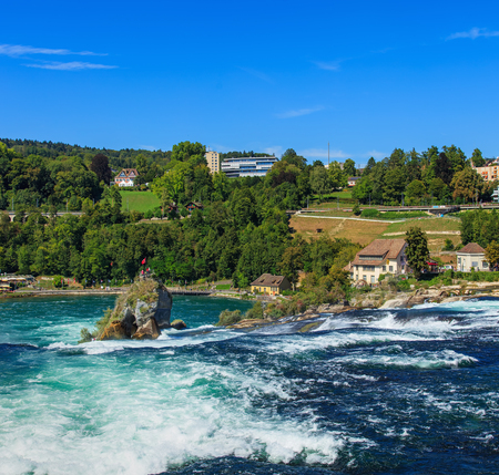 am: Laufen, Switzerland - 29 August, 2015: the Rhine Falls. The Rhine Falls is the largest plain waterfall in Europe, located on the border between the cantons of Schaffhausen and Zurich, between the towns of Neuhausen am Rheinfall and Laufen-Uhwiesen in nort