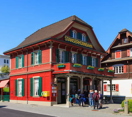 ortseingangsschild: Stans, Switzerland - 7 May, 2016: people at the Stanserhornbahn funicular railroad station in the town of Stans in the Swiss canton of Nidwalden. Stanserhornbahn is a mountain funicular railway from the town of Stans to Mt. Stanserhorn, it has been in ope Editorial