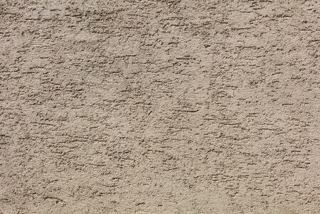 Surface of a plastered wall high resolution backgroundtexture.