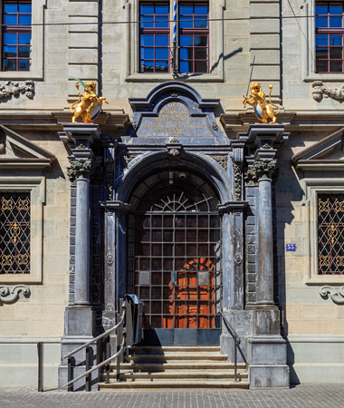 Zurich, Switzerland - 18 June, 2017: entrance to the Rathaus building, closed on Sunday. The Rathaus is Zurichs Town Hall, it was built during 1694-1698, the canton of Zurich owns it since 1803. It houses both legislative chambers - the cantonal parliame