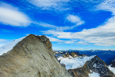 Summit of Mt. Titlis in Switzerland in wintertime. The Titlis is a mountain located on the border between the Swiss cantons of Obwalden and Bern.
