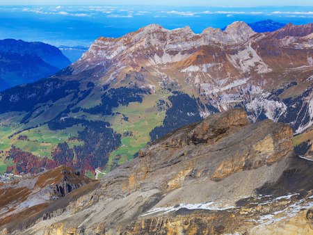 View from Mt. Titlis in the Swiss Alps in autumn. The Titlis is a mountain located on the border between the Swiss cantons of Obwalden and Bern. Stock Photo