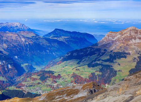 View from Mt. Titlis in the Swiss Alps in autumn. The Titlis is a mountain located on the border between the Swiss cantons of Obwalden and Bern, mainly accessed from the town of Engelberg. Stock Photo