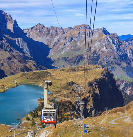 Mt. Titlis, Switzerland - 12 October, 2015: a cable car gondola with passengers on Mt. Titlis. The Titlis (also Mount Titlis) is a mountain of the Alps, located on the border between the Swiss cantons of Obwalden and Bern, it is mainly accessed from the t